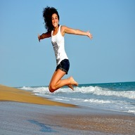 Girl jumping dp with smile in short t-shirt