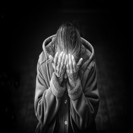 Girl, woman weeping black background and black dress hiding Face by Hands dp