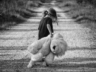 girl with teddy wear alone
