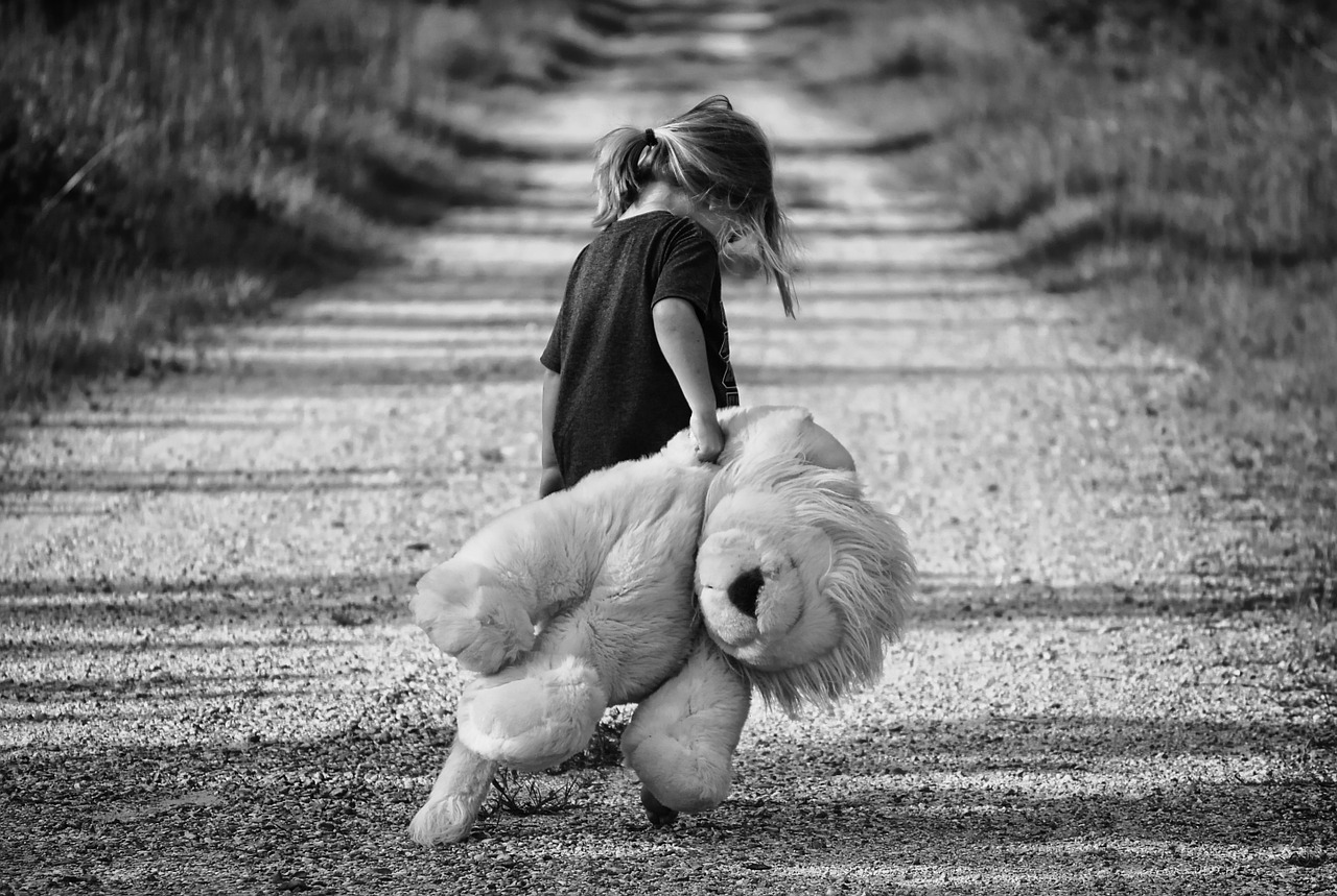 girl with teddy wear alone
