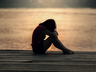 girl alone weeping