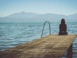 girl alone on beach back side